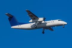 Dash 8. A Dash-8 regional Turboprop aircraft on short final stock photo