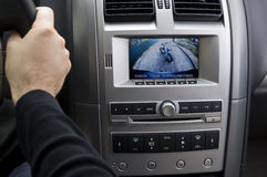 In-dash reversing camera on car (LHD). A stock photo of an in dash reversing camera showing the view of a suburban driveway with a child's bike Royalty Free Stock Images