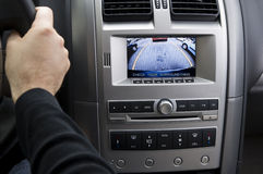 In-dash reversing camera while parking(LHD). A stock photo of an in dash reversing camera showing the view while parking a car Royalty Free Stock Photos