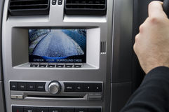 In Dash Reversing camera (RHD). A stock photo of an in dash reversing camera showing the view of a suburban driveway Royalty Free Stock Photography