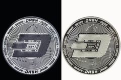 White Dash coin on a black background and a black coin on a white background. stock image
