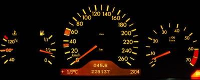 Dashboard. Yellow dashboard on black background stock photos