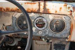 The dashboard of an abandoned, decaying car. stock image