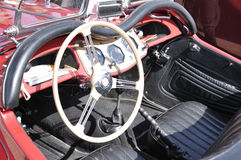 Dashboard of an antique red classic car Stock Images