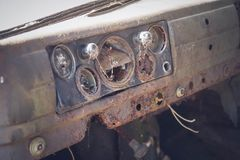 Dashboard of an car. Dashboard of an old abandoned car Royalty Free Stock Photos