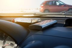 Alcoholic drinks lie near the windshield of the car. royalty free stock photos