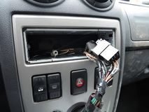 Car dashboard after theft of audio reciever. The dashboard of the car after the theft of a radio stock images
