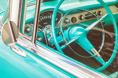 Dashboard of a classic car. Retro styled image of the dashboard of a blue classic car stock photo