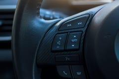 Dashboard control on steering wheel. Dashboard control on the steering wheel Stock Image