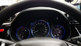 Dashboard controller status of hi-tech car with steering wheel. Background Royalty Free Stock Images