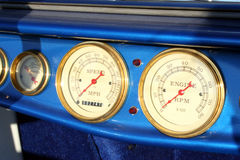 Dashboard Dials. The dials on the dashboard of a classic car Stock Photos
