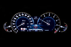 Dashboard and digital display - mileage, fuel consumption, speed. Dashboard and digital display of a modern car, mileage, fuel consumption, speedometer. New and Royalty Free Stock Images