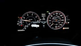 Dashboard of an expensive car. In darkside stock video footage