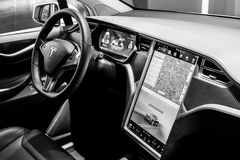The dashboard of a full-sized, all-electric, luxury, crossover SUV Tesla Model X. BERLIN - NOVEMBER 09, 2016: Showroom. The dashboard of a full-sized, all Royalty Free Stock Photography