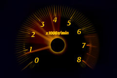 Dashboard gauges. Car dashboard gauges illuminated at night, motion look Stock Images
