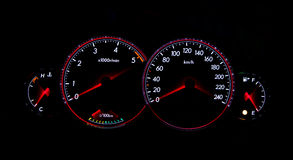 Dashboard gauges. Car dashboard gauges illuminated at night, tachometer, speedometer Stock Photos