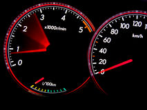 Dashboard gauges. Car dashboard gauges illuminated at night, tachometer, speedometer Royalty Free Stock Image