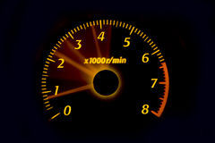 Dashboard gauges. Car dashboard gauges illuminated at night, tachometer, speedometer Royalty Free Stock Photography