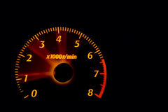 Dashboard gauges. Car dashboard gauges illuminated at night, tachometer, speedometer Stock Image