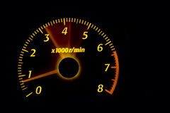 Dashboard gauges. Car dashboard gauges illuminated at night, tachometer, speedometer Royalty Free Stock Photos