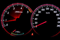 Dashboard gauges. Car dashboard gauges illuminated at night, tachometer, speedometer Stock Photo