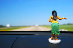 Dashboard Hula Girl. A hula girl leads you on a road trip to fun and adventure Stock Photo