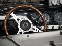 Dashboard of an old british classic car. Particular view of steering wheel and vehicle instrument panel . The car is a Triumph TR. 3 model produced between 1955 Royalty Free Stock Photography
