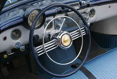 Dashboard of an old car. Dashboard of a Vintage car with vivid colors Stock Photos