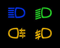 Dashboard Signs. Car lights isolated on black Stock Photos