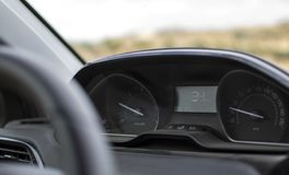Dashboard and speedometer in a new car royalty free stock photography