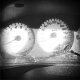 Dashboard. Speedometer and rev counter in car dashboard Stock Images