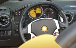 Dashboard and steering wheel. Modern gray dashboard to exotic italian sportscar stock image