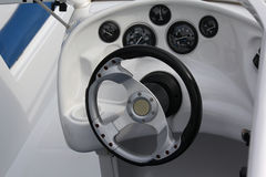 Dashboard and the steering wheel of the cabin of the motor boat stock photography