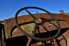 Dashboard and steering wheel of an old truck. Dash and steering wheeling is all which is left of an old truck Royalty Free Stock Photography
