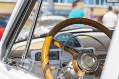 Dashboard and steering wheel of retro car on GAZ21 avtoarena in Cheboksary,. Chuvash Republic, Russia. 08/20/2016 Stock Photos
