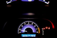 Dashboard of  tachometer car,meter display. Night time Royalty Free Stock Photo