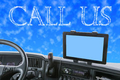 Dashboard of the truck with CALL US words in the blue sky Stock Photos