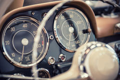 Dashboard of a vintage car Stock Images