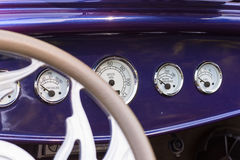 Dashboard in a vintage car Stock Images