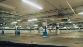 Dashcam view, auto driving through underground parking lot stock video footage