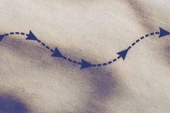 Dashed arrowhead line as a direction to achieve goals Royalty Free Stock Image