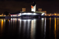 Dashed Night Water Reflections. Reflections on a quick river at night from a famous building in Salford, Manchester, United Kingdom Stock Photos