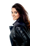 Dashing young girl in leather jacket Stock Photography
