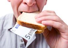 Dass Sie in ein Sandwich legen können - Ihr Geld. Lizenzfreies Stockbild
