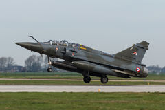 Dassault Mirage 2000 landing at Frisian Flag exercise. A French Dassault Mirage 2000 landing at Frisian Flag exercise after completing it`s mission Stock Photography