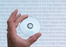 DATA. A HAND WITH MINI CD BEHIND IT BINARY CODE royalty free stock photo