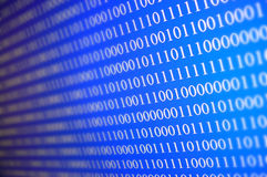 Data. Binary data depicted as white ones and zeroes on a blue screen Royalty Free Stock Photography