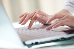 Data access. Woman's hands pressing keys on a laptop keyboard trying to access data Stock Photography