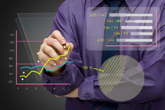 Data analysis. Businessman analyze the business graph Stock Photos