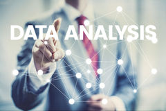 Data analysis concept business man pointing interface Royalty Free Stock Image